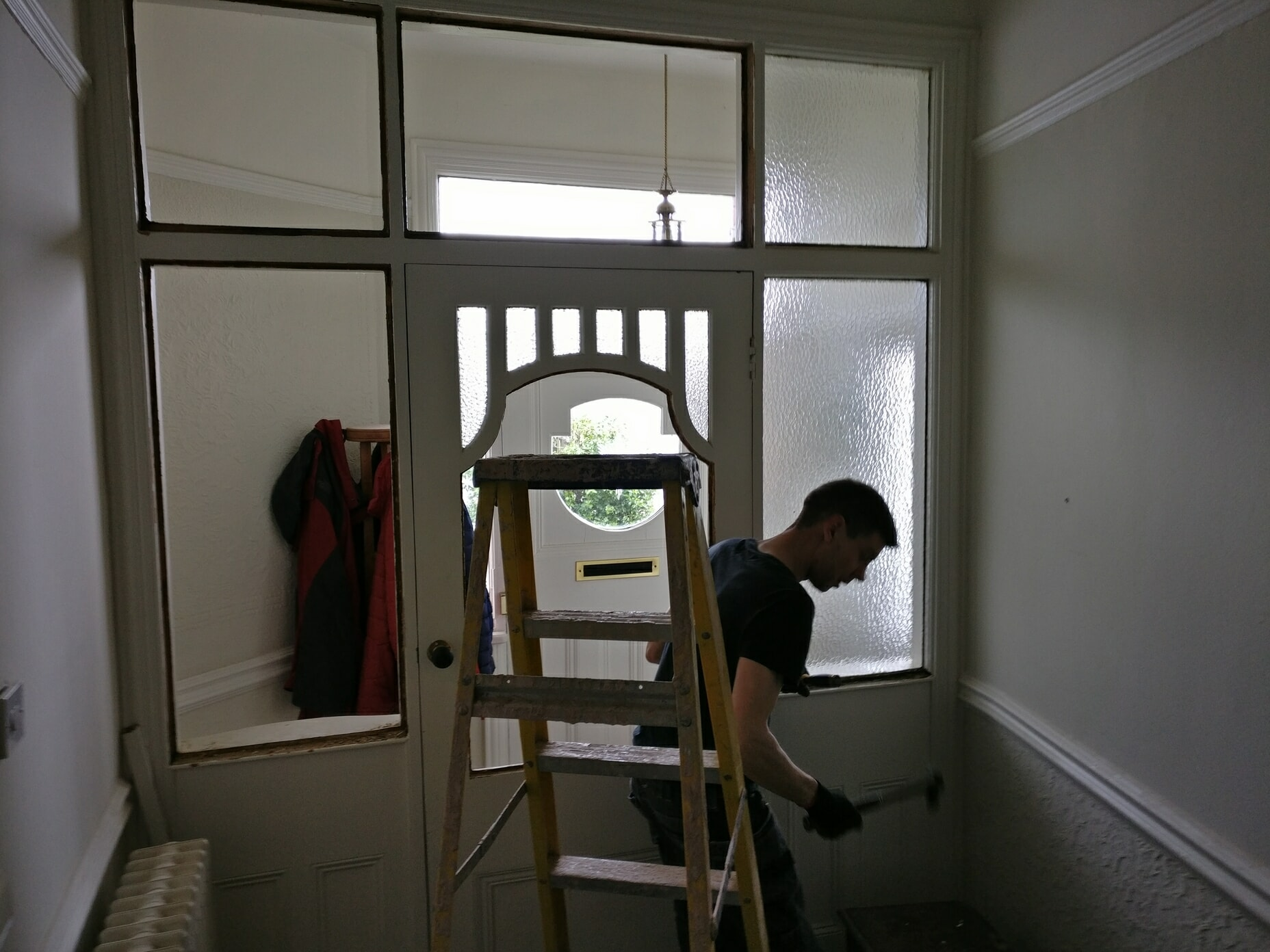 man decorating in a house