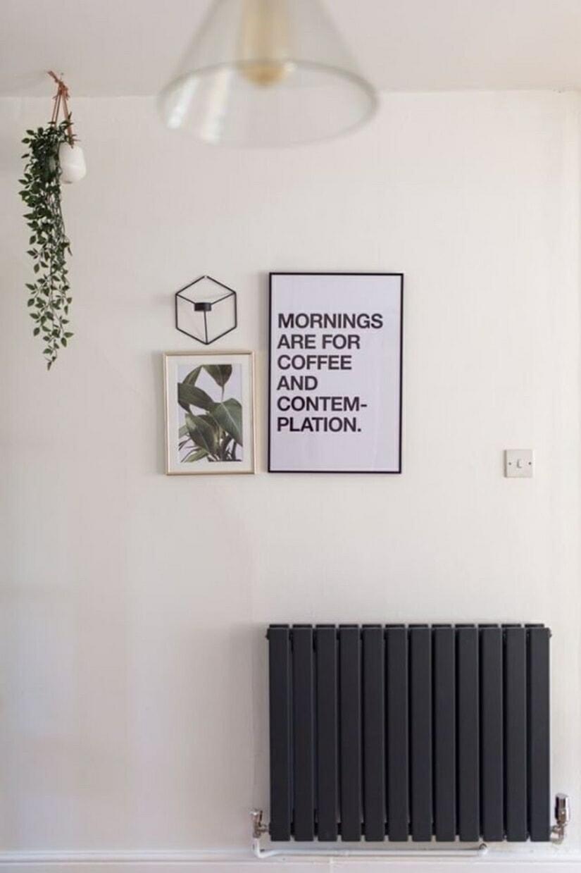 Milano Alpha antracite designer radiator on a white wall.