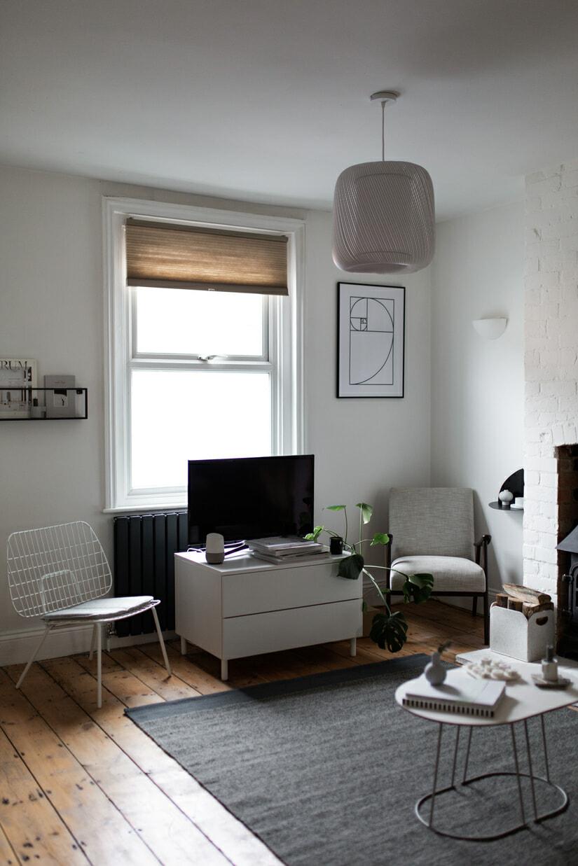 Milano Alpha designer radiator in a modern living room.