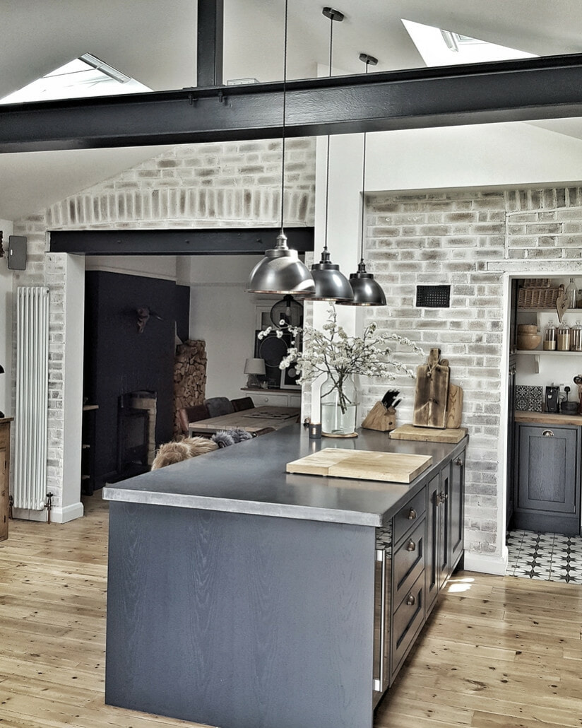open plan kitchen with a vertical radiator