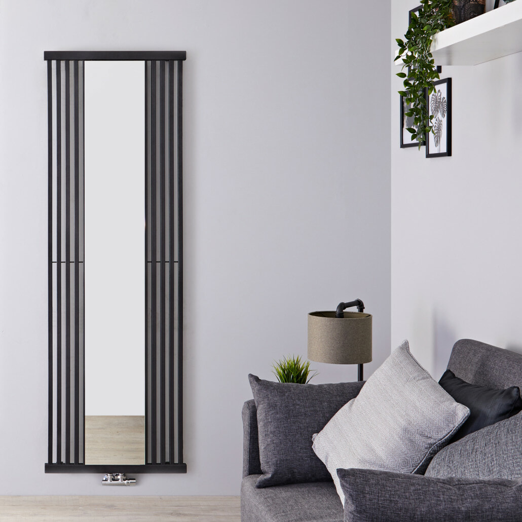 Terma Intra vertical radiator on a grey wall in a living room