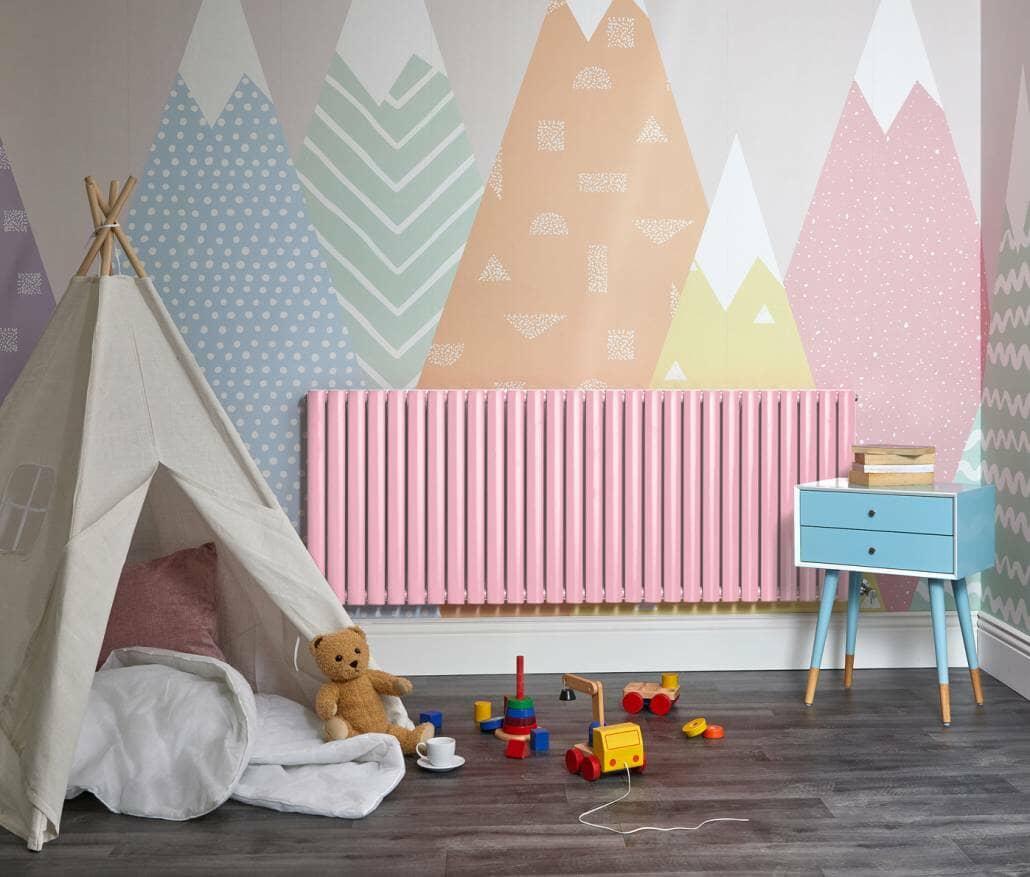 Pink Milano Aruba designer radiator in a playroom