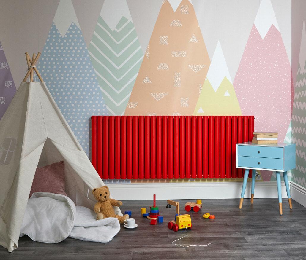 Red Milano Aruba designer radiator in a playroom