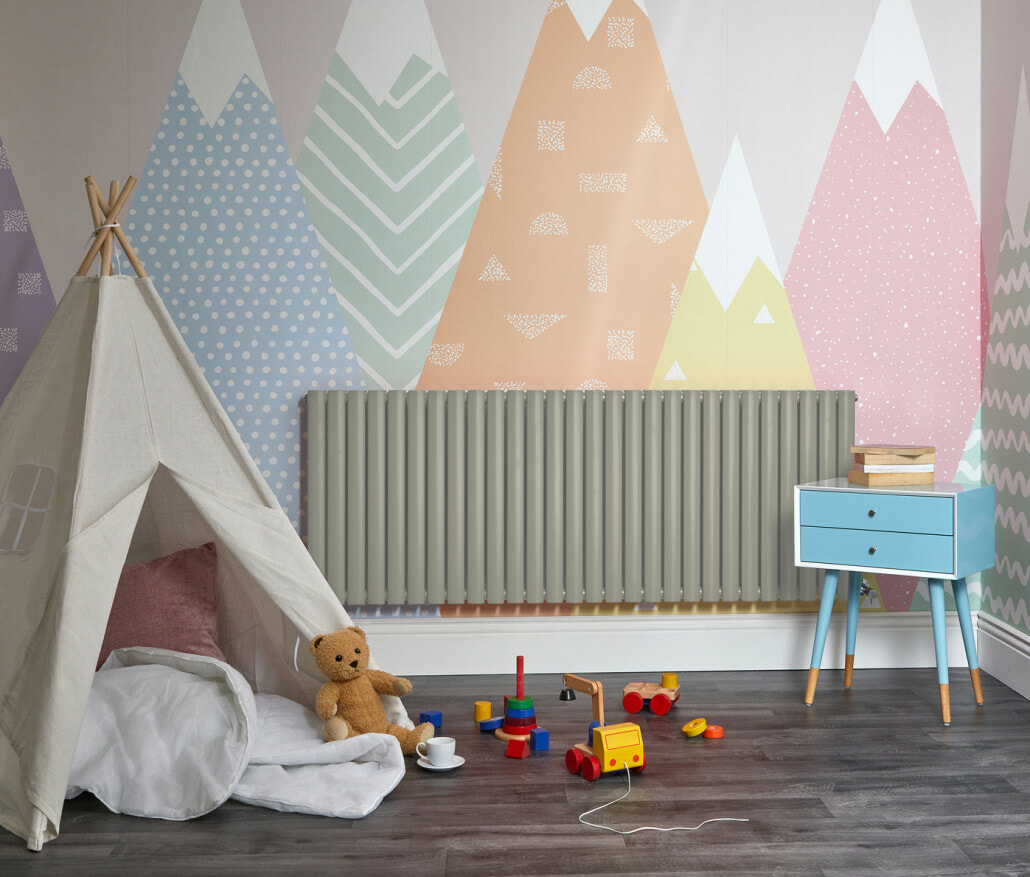 Sage green Milano Aruba designer radiator in a playroom