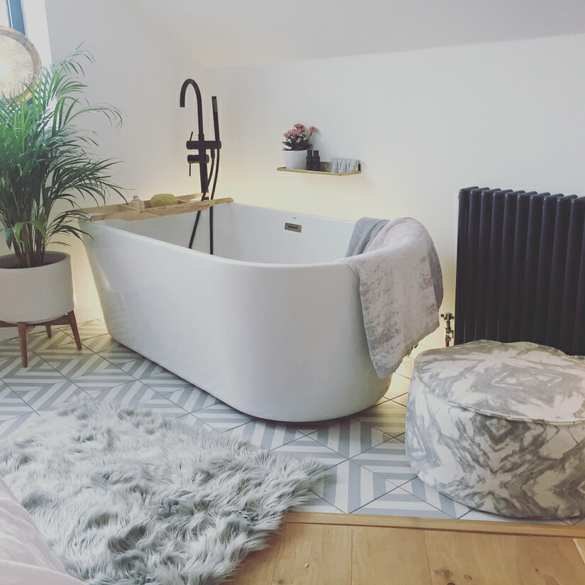 Freestanding bath and a Milano Windsor radiator.