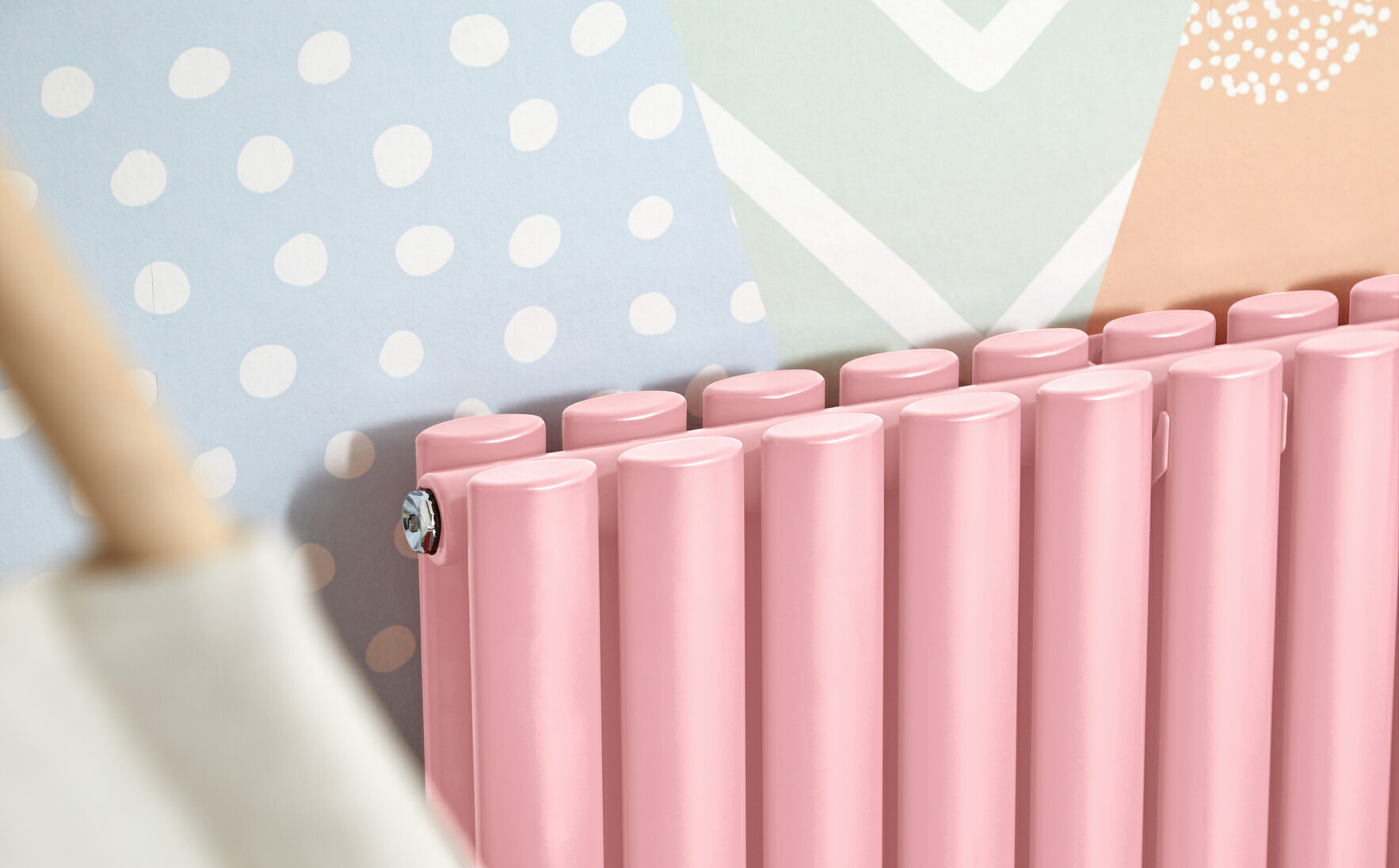close up of a pink Milano Aruba designer radiator