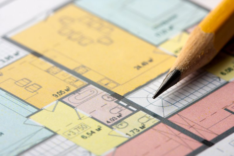 an architectural floor plan with a pencil