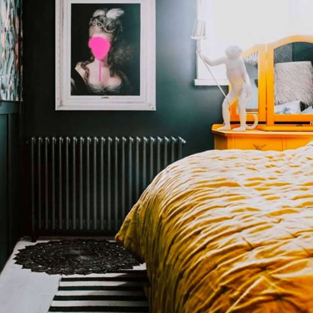 Milano Windsor column radiator on a grey wall