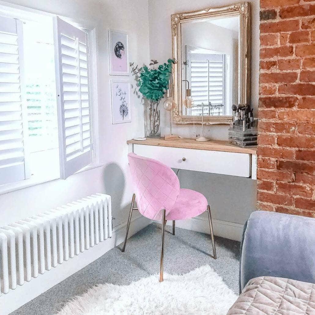 Low level Milano Windsor column radiator in a dressing room