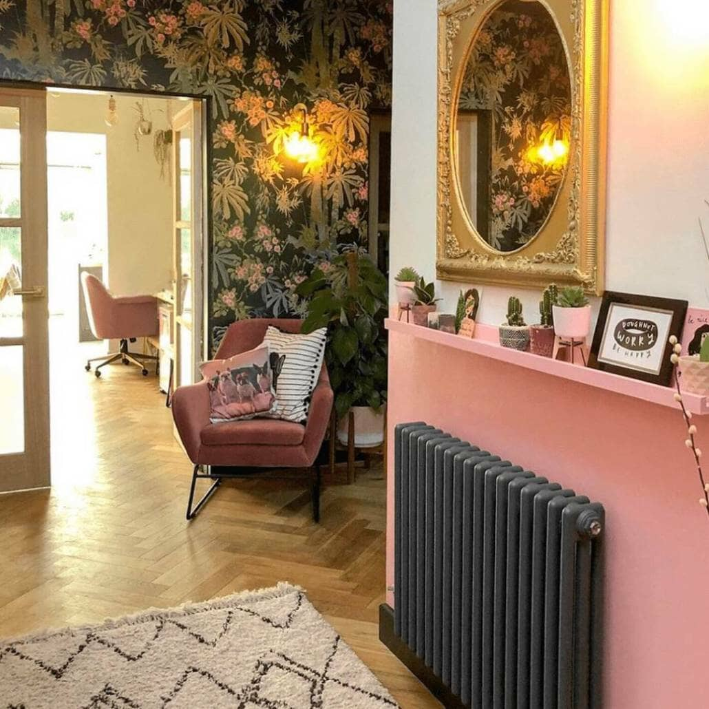 Milano Windsor anthracite radiator on a pink wall