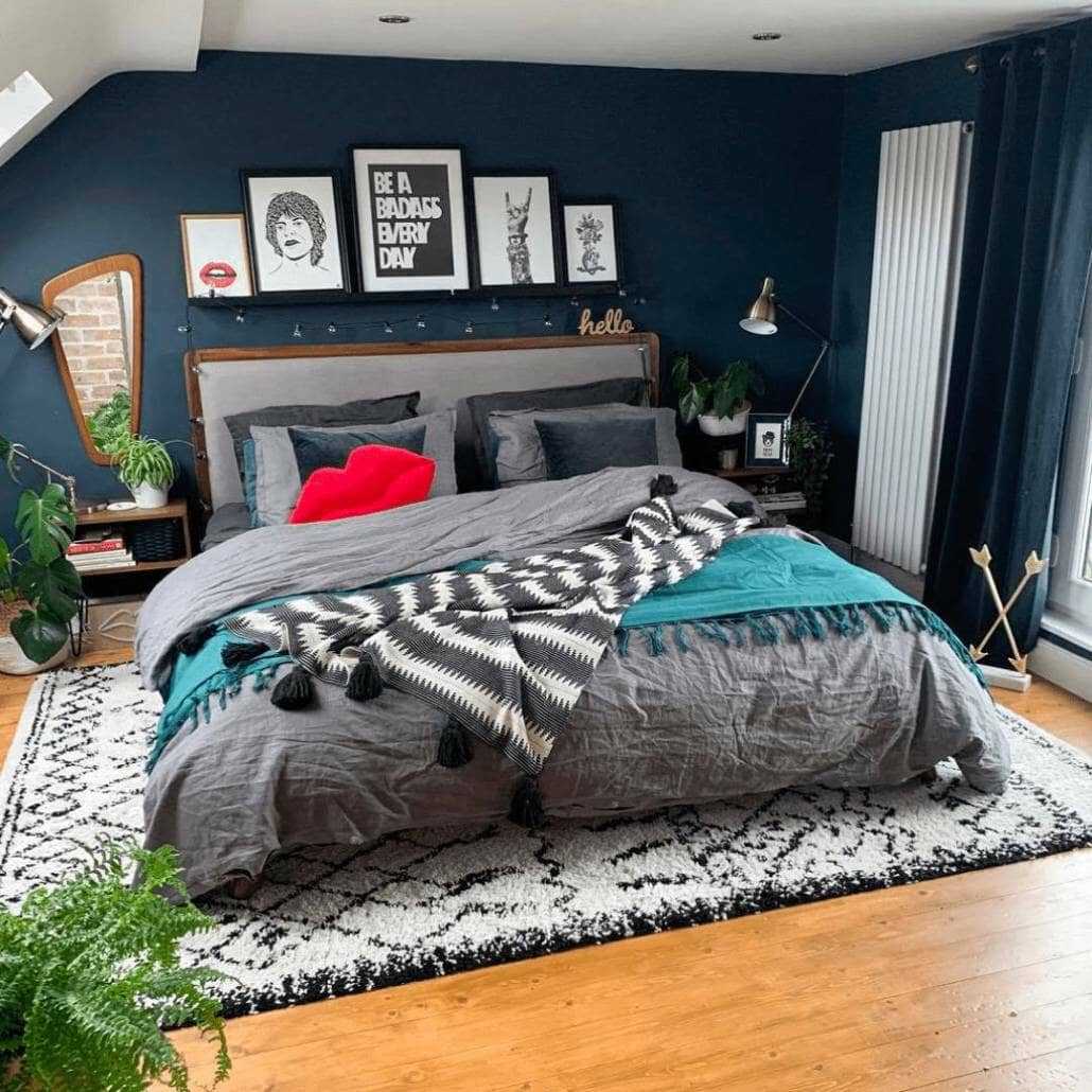 Milano Aruba white vertical radiator in a navy bedroom