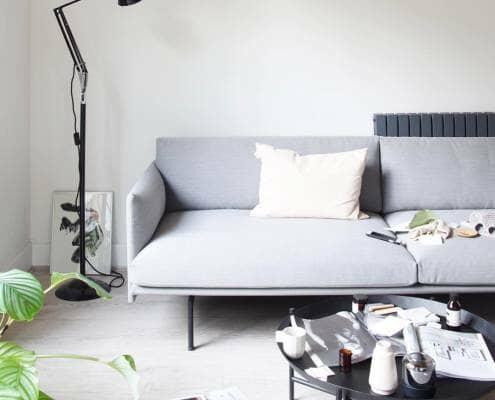 Milano Alpha designer radiator behind a modern sofa
