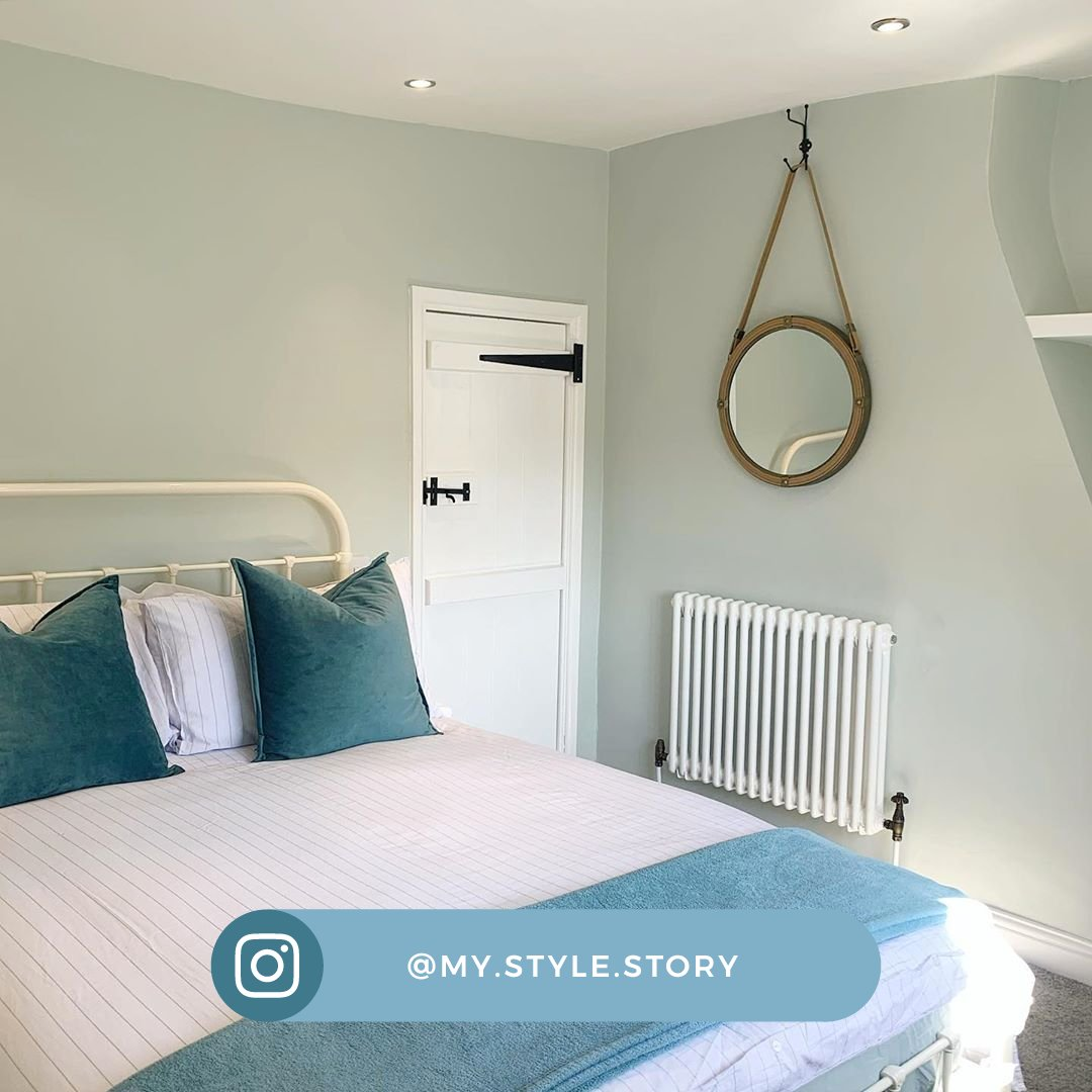 white radiator in a calm blue bedroom