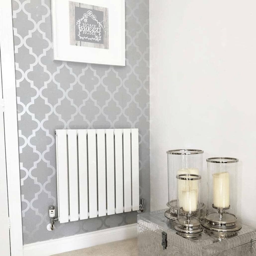 White Milano Alpha radiator on a silver wall