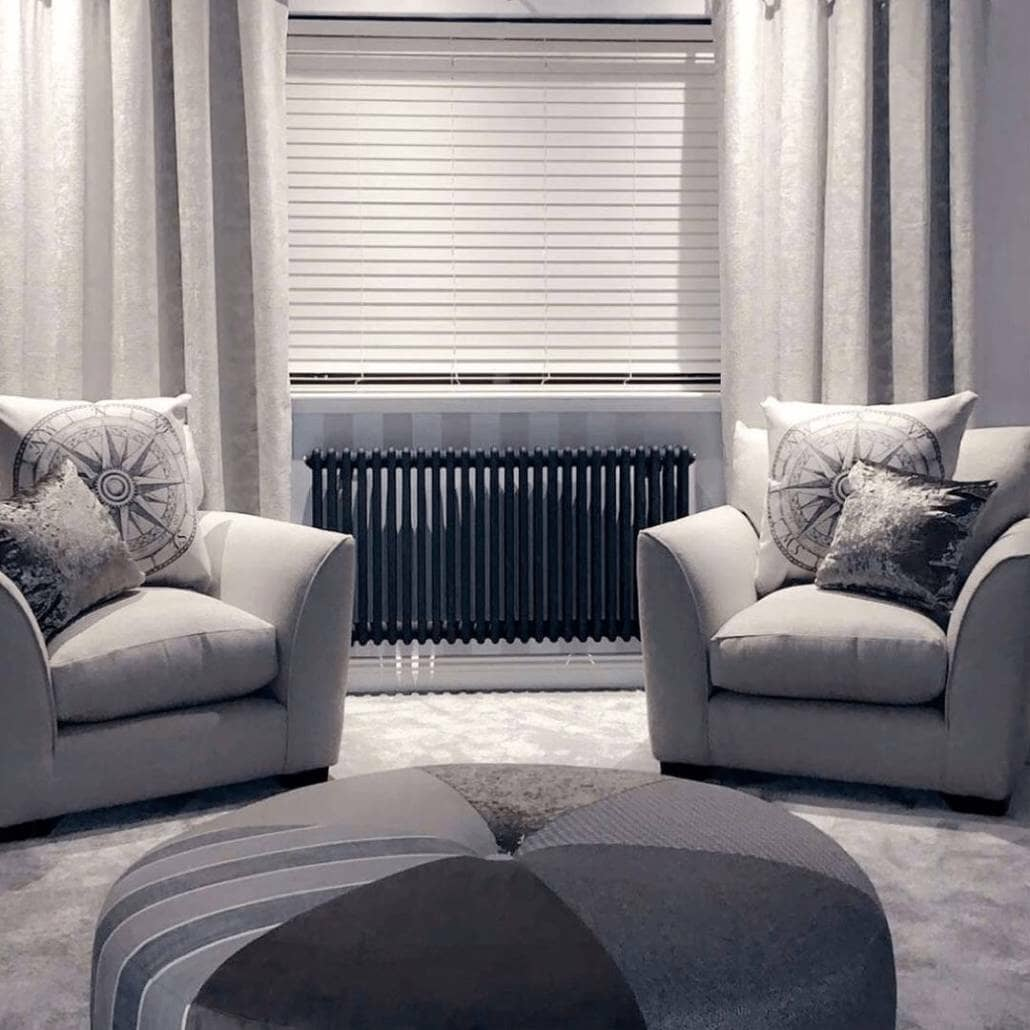 Milano Windsor anthracite radiator in a grey living room