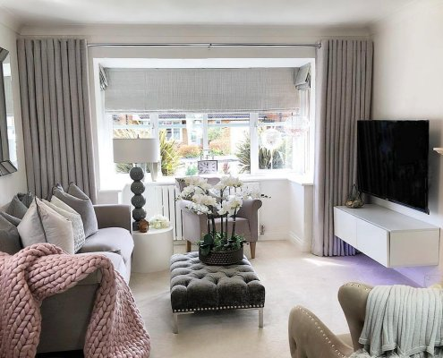 White Milano Alpha radiator in a pink and grey living room