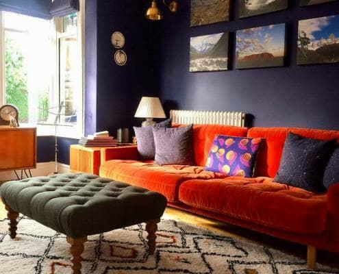 Milano Windsor column radiator behind an orange sofa
