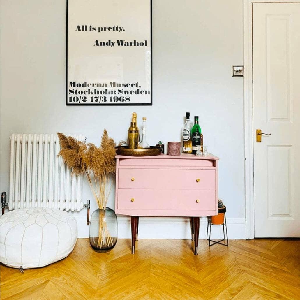 Milano Windsor column radiator next to a pink bar cart