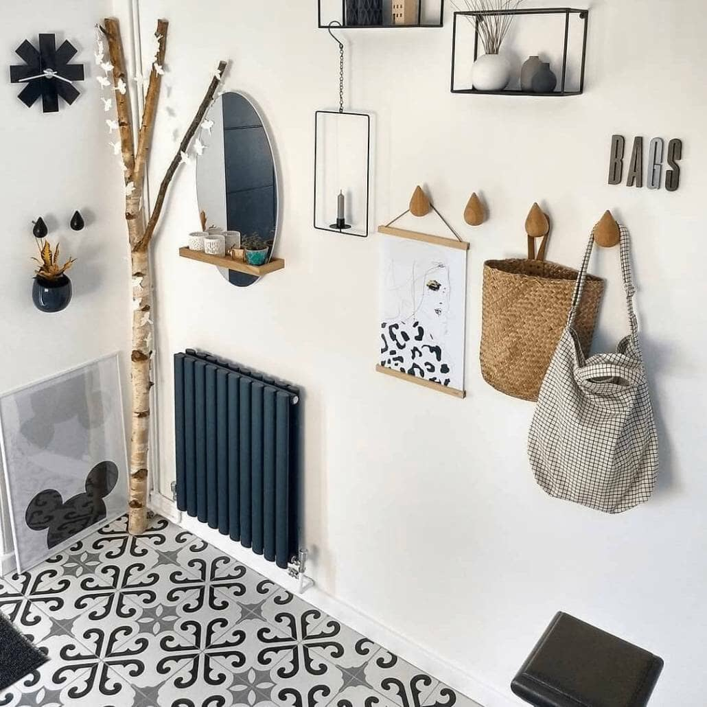 Milano Aruba anthracite radiator in a scandi style hallway