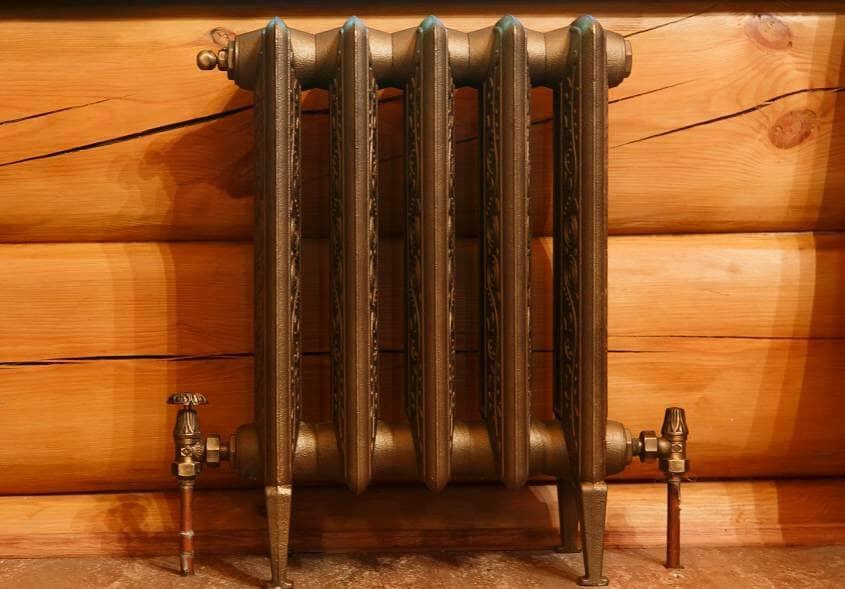 Cast iron retro radiator in timber home