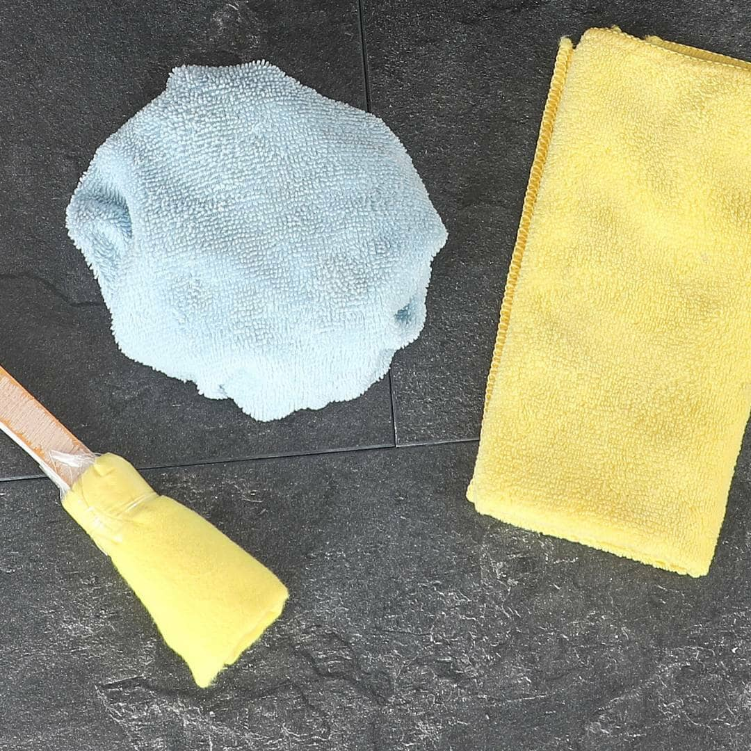 radiator brushes and cloths on a tile floor