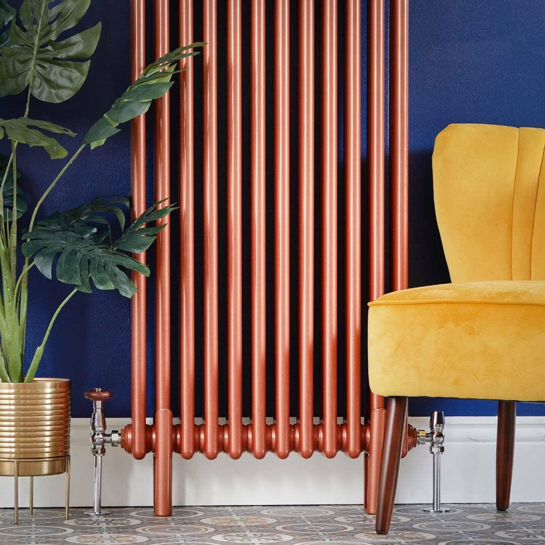 Copper column radiator on a blue wall