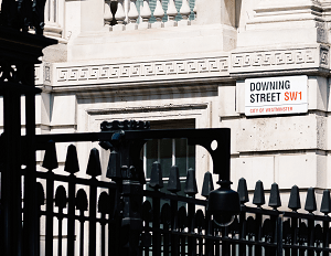 a street sign showing the name of Downing street in London