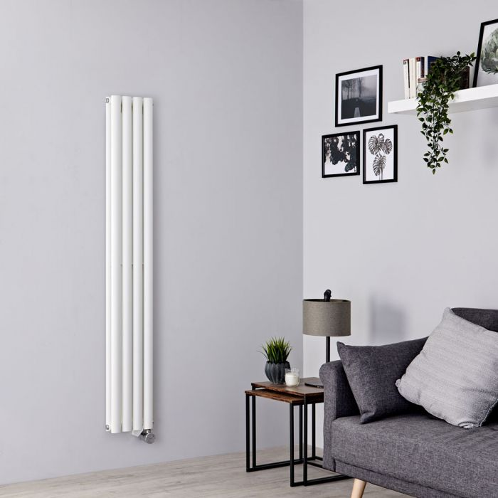 white vertical electric radiator in a grey living room