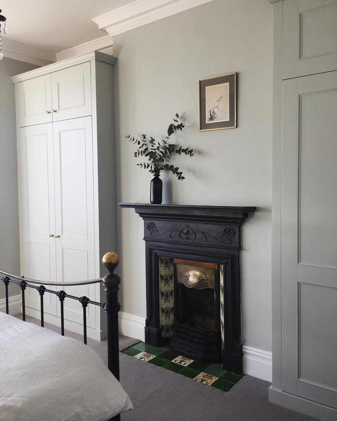 An original Edwardian fireplace in a bedroom.