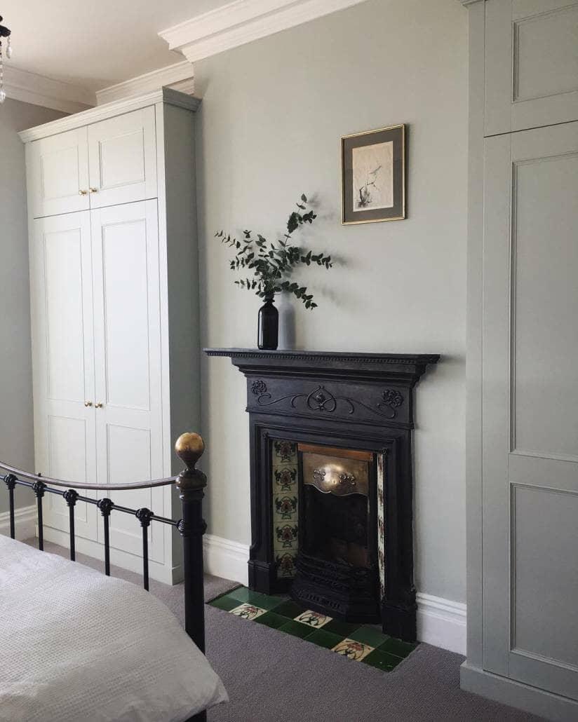 An original Edwardian fireplace in a bedroom.