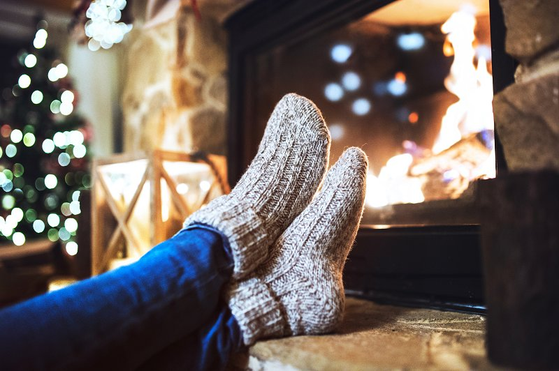 feet up in front of the fire