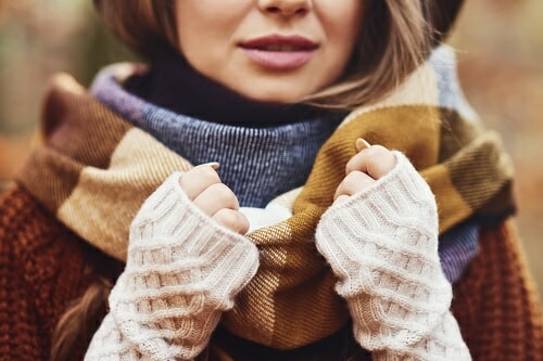 a woman wearing a lot of clothing layers