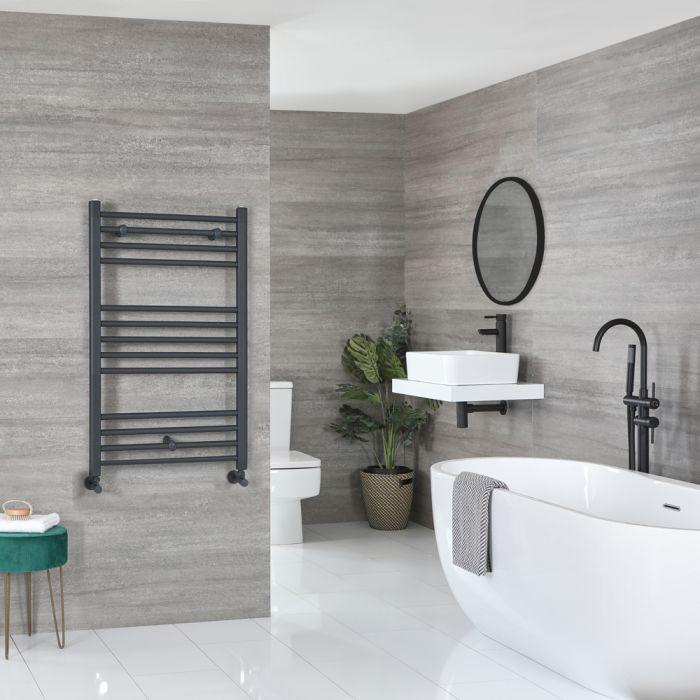 Milano Artle heated towel rail in a grey bathroom