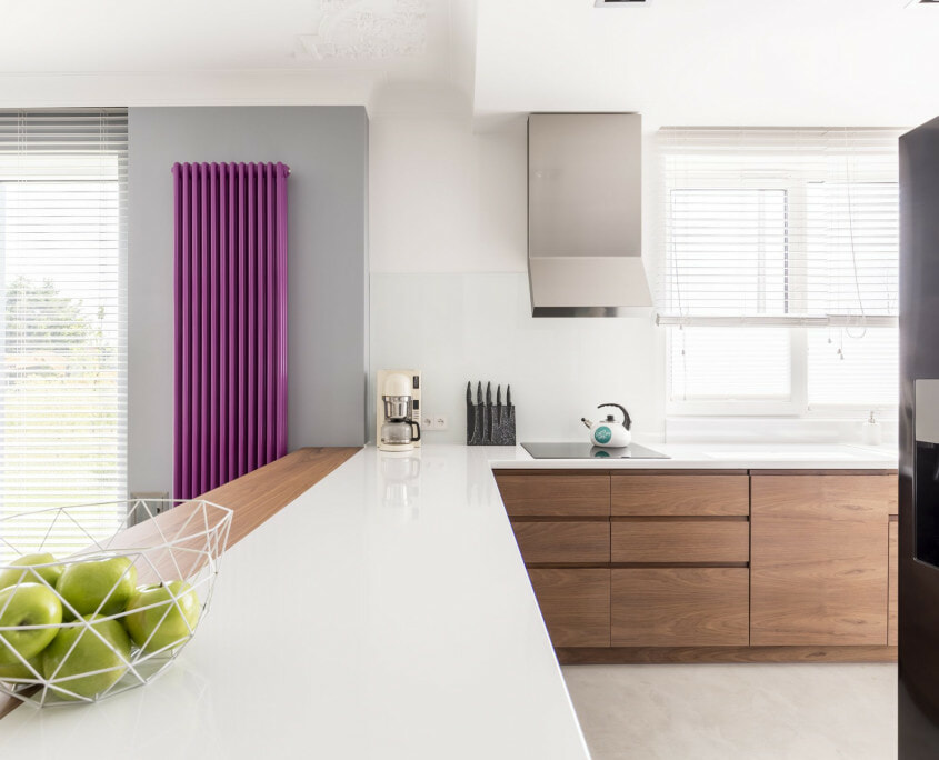 Purple radiator in large kitchen space