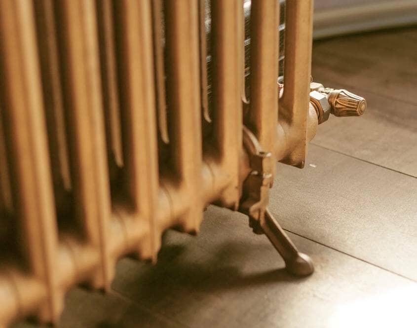 Vintage gold cast iron radiator