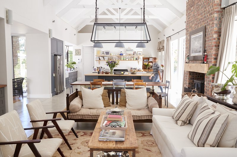 open plan space with feature fireplace