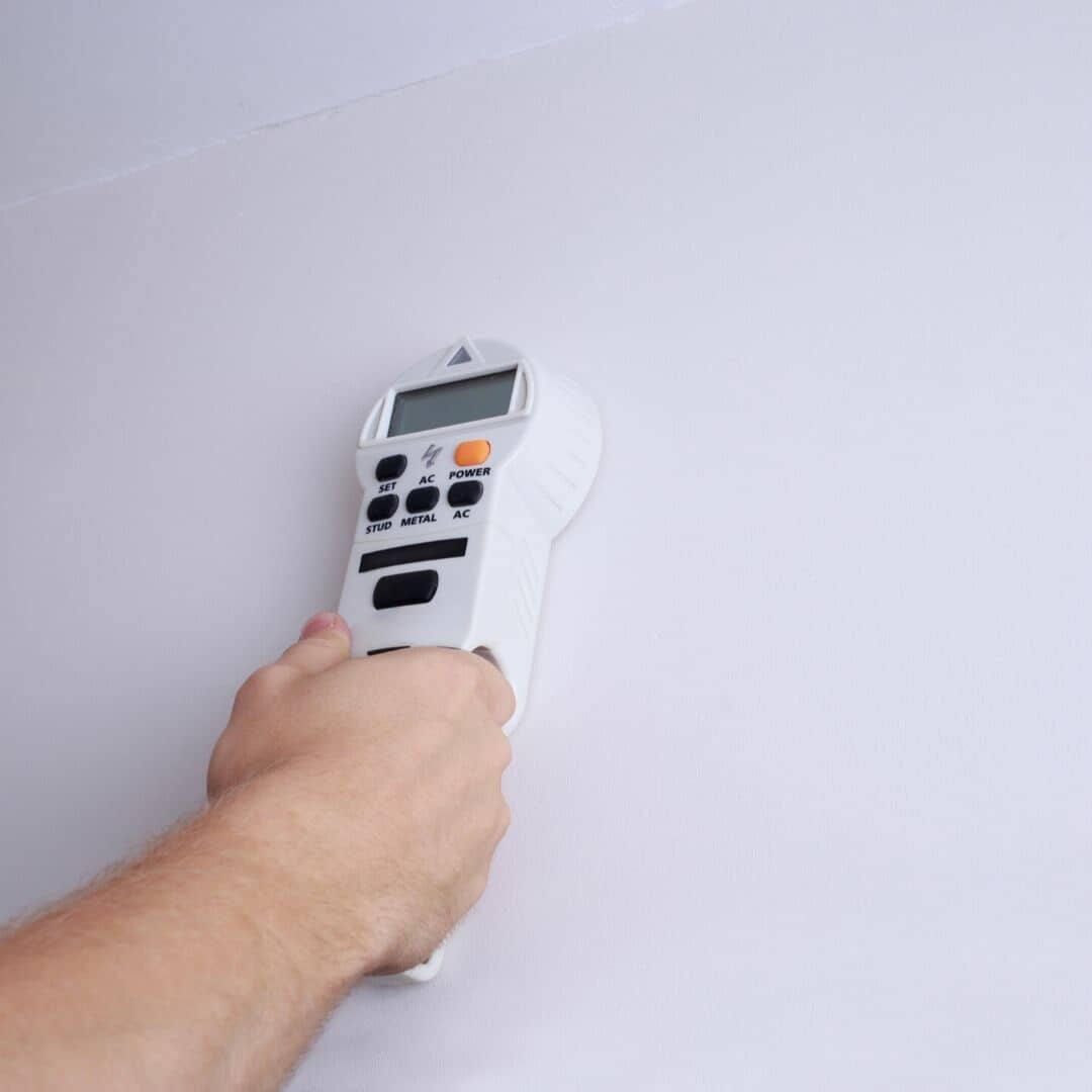 hand holding a wall scanner