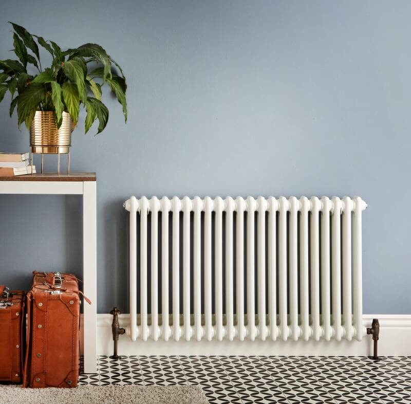 a white windsor radiator in a hallway